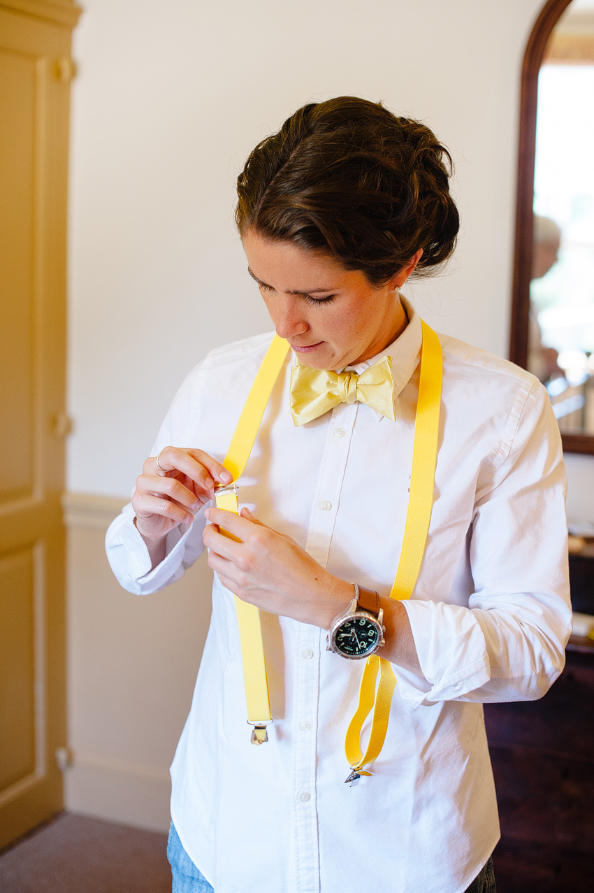 bride adjusting suit