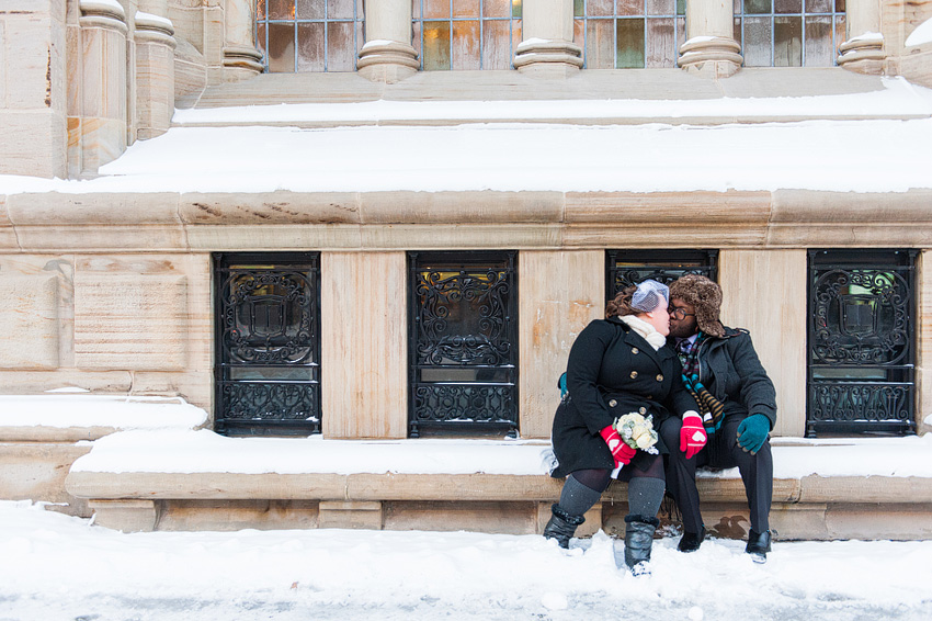 bride and groom kissing in winter