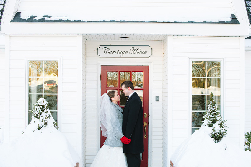 couple outside carriage house on wedding day