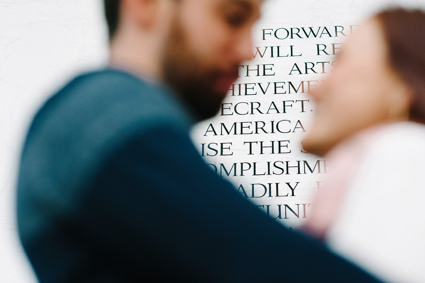 couple in front of kennedy center wall